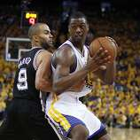 Harrison Barnes (40) drives the ball defended by Tony Parker (9) in the second half. The Golden State Warriors played the San Antonio Spurs in Game 4 of the Wester Conference Semifinals at Oracle Arena in Oakland, Calif., on Sunday, May 12, 2013.