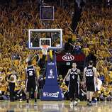 The Warriors fans try their best to distract Kawhi Leonard (2) as he shoots a free throw late in the second half. The Golden State Warriors played the San Antonio Spurs in Game 4 of the Wester Conference Semifinals at Oracle Arena in Oakland, Calif., on Sunday, May 12, 2013.