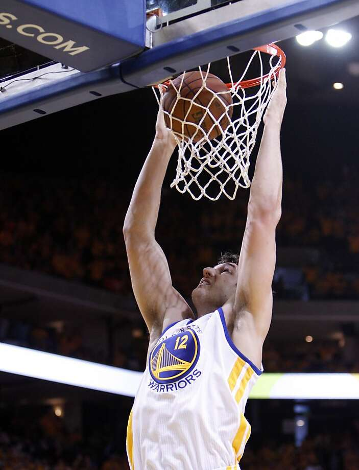 Andrew Bogut (12) dunks the ball in the second half. The Golden State Warriors played the San Antonio Spurs in Game 4 of the Wester Conference Semifinals at Oracle Arena in Oakland, Calif., on Sunday, May 12, 2013. Photo: Carlos Avila Gonzalez, The Chronicle