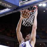 Andrew Bogut (12) dunks the ball in the second half. The Golden State Warriors played the San Antonio Spurs in Game 4 of the Wester Conference Semifinals at Oracle Arena in Oakland, Calif., on Sunday, May 12, 2013.