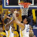 Andrew Bogut (12) gets to a rebound before Harrison Barnes (40) in the second half. The Golden State Warriors played the San Antonio Spurs in Game 4 of the Wester Conference Semifinals at Oracle Arena in Oakland, Calif., on Sunday, May 12, 2013.