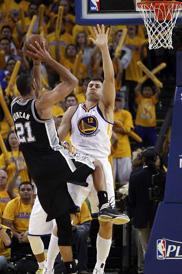 Andrew Bogut (12) defends against Tim Duncan (21) in the second half. The Golden State Warriors played the San Antonio Spurs in Game 4 of the Wester Conference Semifinals at Oracle Arena in Oakland, Calif., on Sunday, May 12, 2013. Photo: Carlos Avila Gonzalez, The Chronicle