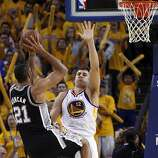 Andrew Bogut (12) defends against Tim Duncan (21) in the second half. The Golden State Warriors played the San Antonio Spurs in Game 4 of the Wester Conference Semifinals at Oracle Arena in Oakland, Calif., on Sunday, May 12, 2013.