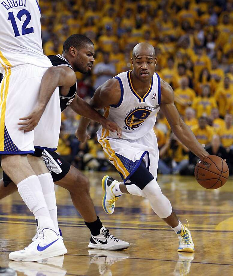 Jarrett Jack (2) drives the ball defended by Gary Neal (14) in the second half. The Golden State Warriors played the San Antonio Spurs in Game 4 of the Wester Conference Semifinals at Oracle Arena in Oakland, Calif., on Sunday, May 12, 2013. Photo: Carlos Avila Gonzalez, The Chronicle