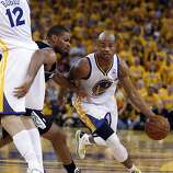 Jarrett Jack (2) drives the ball defended by Gary Neal (14) in the second half. The Golden State Warriors played the San Antonio Spurs in Game 4 of the Wester Conference Semifinals at Oracle Arena in Oakland, Calif., on Sunday, May 12, 2013.