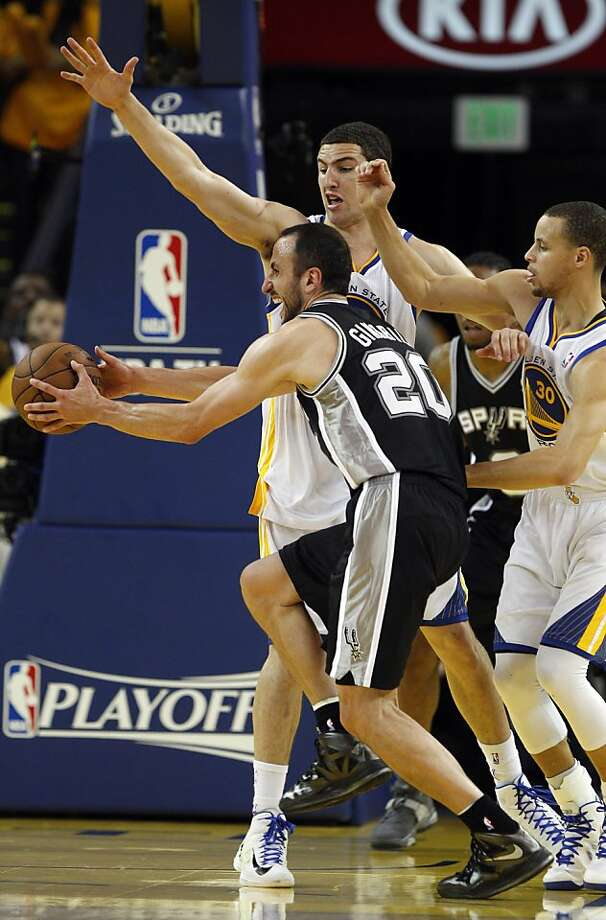Manu Ginobli (20) tries to drive for the basket defended by Klay Thompson, (11) and Stephen Curry (30) in the second half. The Golden State Warriors played the San Antonio Spurs in Game 4 of the Wester Conference Semifinals at Oracle Arena in Oakland, Calif., on Sunday, May 12, 2013. Photo: Carlos Avila Gonzalez, The Chronicle