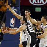 Manu Ginobli (20) tries to drive for the basket defended by Klay Thompson, (11) and Stephen Curry (30) in the second half. The Golden State Warriors played the San Antonio Spurs in Game 4 of the Wester Conference Semifinals at Oracle Arena in Oakland, Calif., on Sunday, May 12, 2013.
