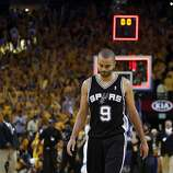 Tony Parker (9) walks off the court after the Warriors won 97-87 in overtime. The Golden State Warriors played the San Antonio Spurs in Game 4 of the Wester Conference Semifinals at Oracle Arena in Oakland, Calif., on Sunday, May 12, 2013.