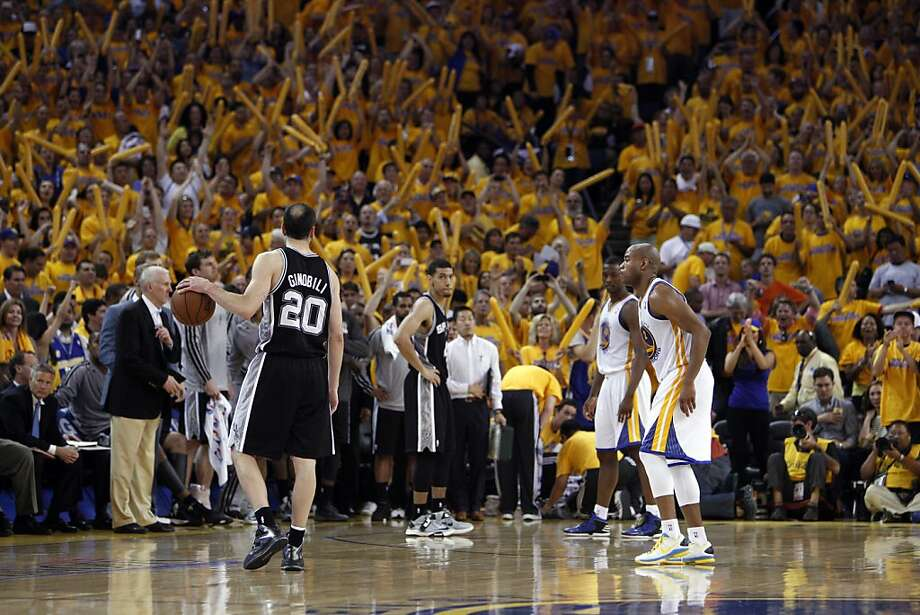 Manu Ginobli (20) just dribbles the ball on the Spurs final possesion letting the time run out in the overtime period. The Golden State Warriors played the San Antonio Spurs in Game 4 of the Wester Conference Semifinals at Oracle Arena in Oakland, Calif., on Sunday, May 12, 2013. Photo: Carlos Avila Gonzalez, The Chronicle