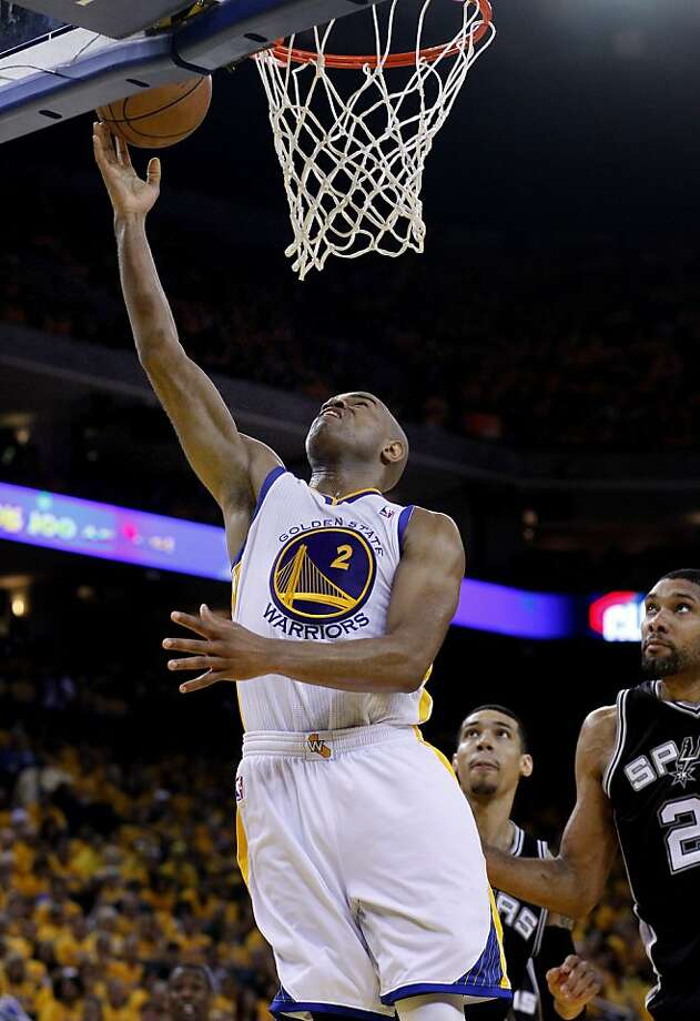 Jarrett Jack (2) went up for two points against Tim Duncan in the first half. The Golden State Warriors beat the San Antonio Spurs 97-87 in the playoffs Sunday May 12, 2013 at Oracle Arena in Oakland, Calif. Photo: Brant Ward, The Chronicle