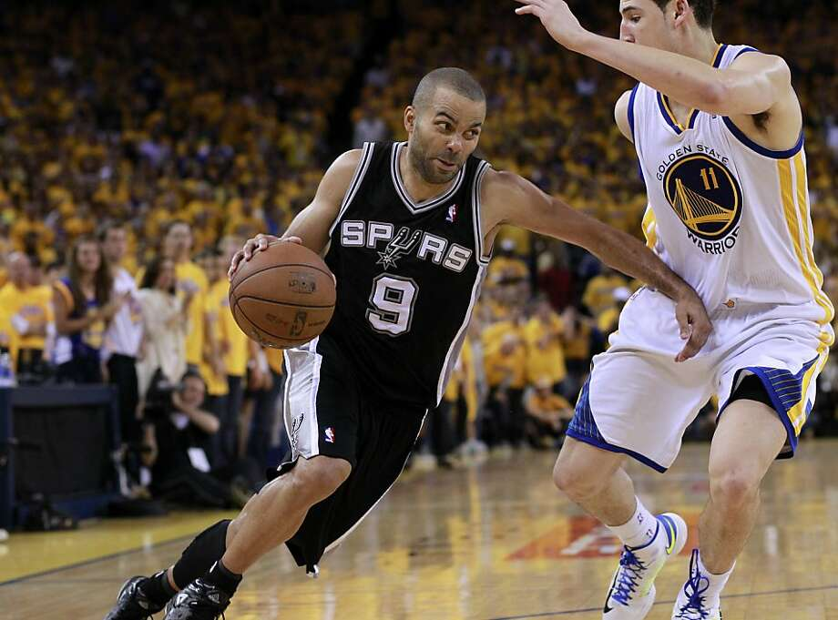 Tony Parker (9)of the Spurs made a move on Klay Thompson (11) in the second half. The Golden State Warriors beat the San Antonio Spurs 97-87 in the playoffs Sunday May 12, 2013 at Oracle Arena in Oakland, Calif. Photo: Brant Ward, The Chronicle