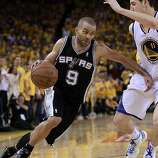 Tony Parker (9)of the Spurs made a move on Klay Thompson (11) in the second half. The Golden State Warriors beat the San Antonio Spurs 97-87 in the playoffs Sunday May 12, 2013 at Oracle Arena in Oakland, Calif.