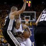 Jarrett Jack (2) made a move around Tony Parker in the first half. The Golden State Warriors beat the San Antonio Spurs 97-87 in the playoffs Sunday May 12, 2013 at Oracle Arena in Oakland, Calif.