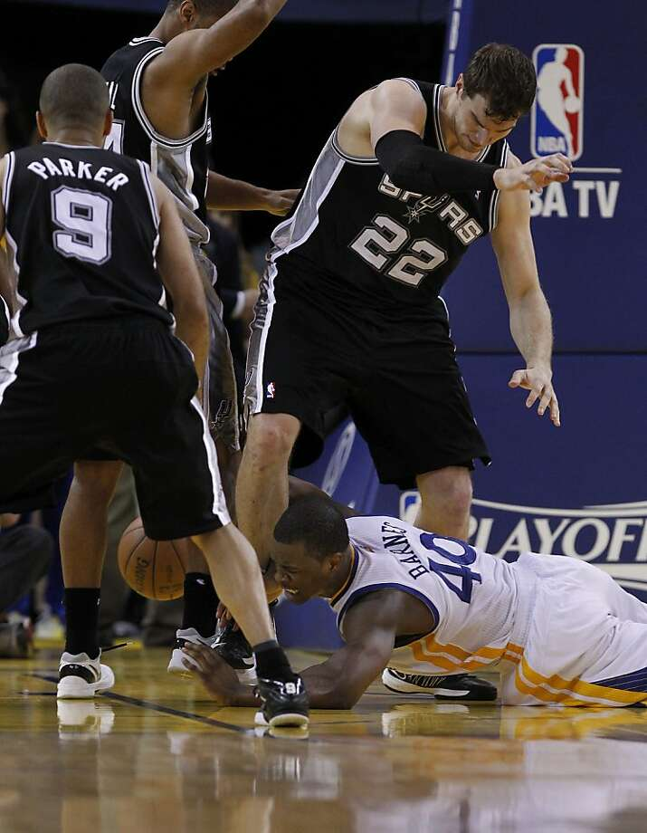 Harrison Barnes (40) tried to retrieve a loose ball under the basket in the second half. The Golden State Warriors beat the San Antonio Spurs 97-87 in the playoffs Sunday May 12, 2013 at Oracle Arena in Oakland, Calif. Photo: Brant Ward, The Chronicle