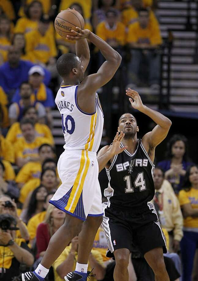 Harrison Barnes (40) of the Warriors went up for two points against Gary Neal (14) in the second half. The Golden State Warriors beat the San Antonio Spurs 97-87 in the playoffs Sunday May 12, 2013 at Oracle Arena in Oakland, Calif. Photo: Brant Ward, The Chronicle