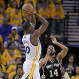 Harrison Barnes (40) of the Warriors went up for two points against Gary Neal (14) in the second half. The Golden State Warriors beat the San Antonio Spurs 97-87 in the playoffs Sunday May 12, 2013 at Oracle Arena in Oakland, Calif.
