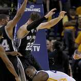 Harrison Barnes (40) grimaced as he tried to get a loose ball under the basket in the second half. The Golden State Warriors beat the San Antonio Spurs 97-87 in the playoffs Sunday May 12, 2013 at Oracle Arena in Oakland, Calif.