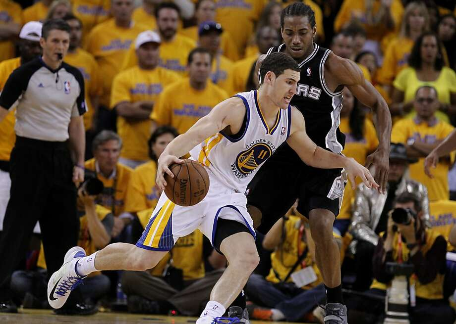 Klay Thompson (11) of the Warriors ran past Kawhi Leonard (2) in the second half.The Golden State Warriors beat the San Antonio Spurs 97-87 in the playoffs Sunday May 12, 2013 at Oracle Arena in Oakland, Calif. Photo: Brant Ward, The Chronicle