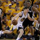 Klay Thompson (11) of the Warriors ran past Kawhi Leonard (2) in the second half.The Golden State Warriors beat the San Antonio Spurs 97-87 in the playoffs Sunday May 12, 2013 at Oracle Arena in Oakland, Calif.