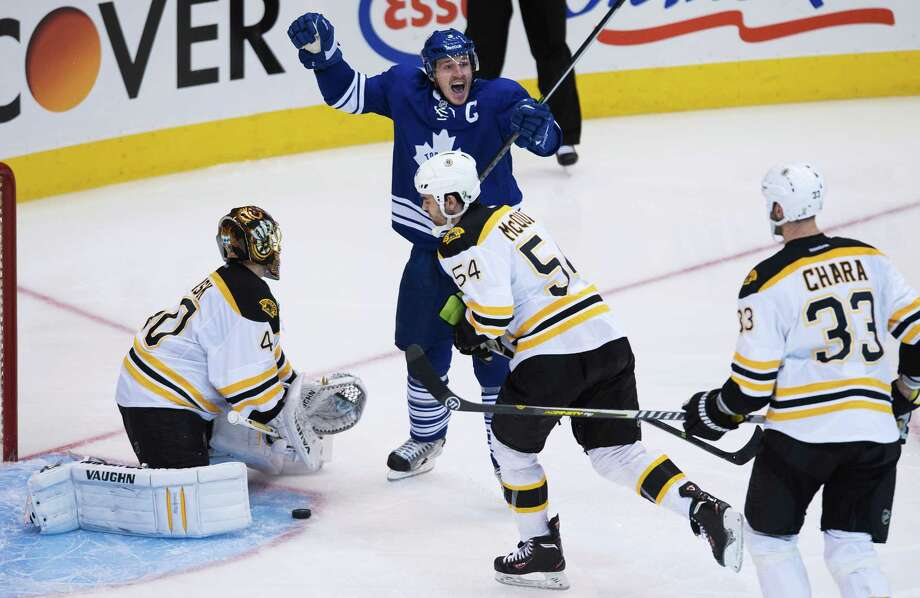 Toronto Maple Leafs defenceman Dion Phaneuf, back center, reacts after scoring past Boston Bruins goalie Tuuka Rask, left, as Bruins defenceman Adam McQuaid, center, and  Zdeno Chara, right, look on during third period NHL hockey playoff action in Toronto on Sunday, May 12, 2013. Photo: The Canadian Press, Nathan Denette