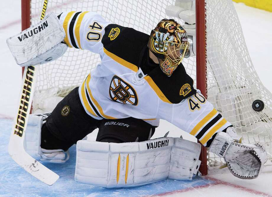 Boston Bruins goalie Tuuka Rask makes a save while playing against the Toronto Maple Leafs during second period NHL hockey playoff action in Toronto on Sunday, May 12, 2013. Photo: The Canadian Press, Nathan Denette