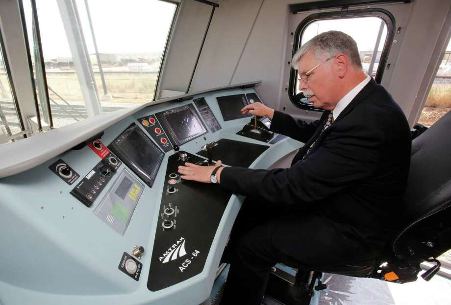 In this photo taken Saturday, May 11, 2013, Joseph Boardman, Amtrak President and CEO, left, looks over the controls of the new Amtrak Cities Sprinter Locomotive that was built by Siemens Rail Systems in Sacramento, Calif.  The new electric locomotive will run on the Northeast intercity rail lines and  replace Amtrak locomotives that have been in service for 20 to 30 years.(AP Photo/Rich Pedroncelli) Photo: Rich Pedroncelli