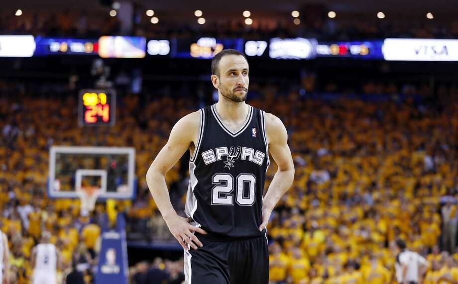 The Spurs' Manu Ginobili walks to the bench during a timeout in overtime action in Game 4 of the Western Conference semifinals Sunday, May 12, 2013 at Oracle Arena in Oakland. The Warriors won 97-87 in overtime.