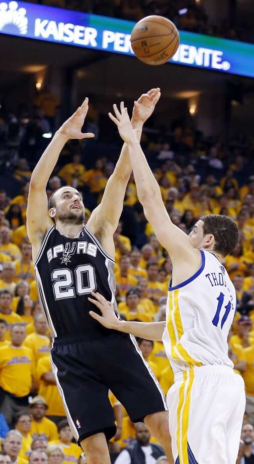 The Spurs' Manu Ginobili shoots over the Warriors' Klay Thompson during Game 4 of the Western Conference semifinals Sunday, May 12, 2013 at Oracle Arena in Oakland. The Warriors won 97-87 in overtime.
