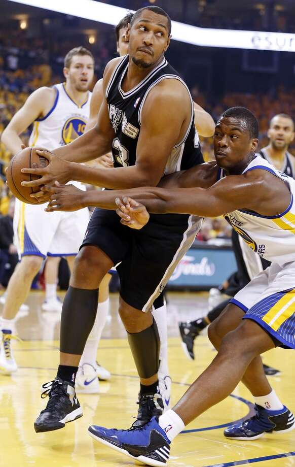 The Spurs' Boris Diaw looks for room around the Warriors' Harrison Barnes during first half action in Game 4 of the Western Conference semifinals Sunday, May 12, 2013 at Oracle Arena in Oakland.