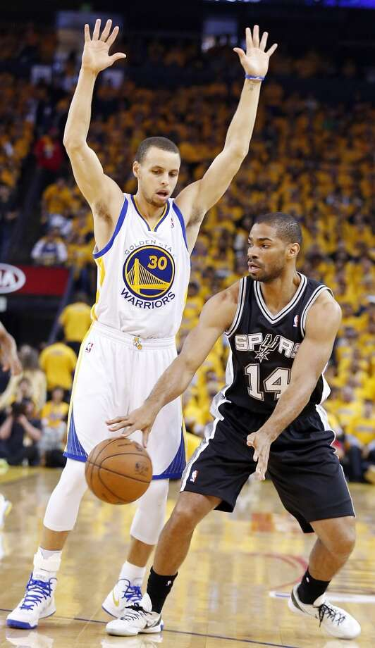 The Spurs' Gary Neal passes around Warriors' Stephen Curry during first half action in Game 4 of the Western Conference semifinals Sunday, May 12, 2013 at Oracle Arena in Oakland.