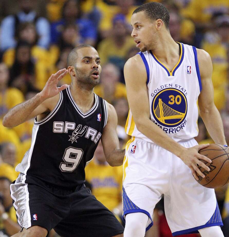 The Spurs' Tony Parker defends the Warriors' Stephen Curry during first half action in Game 4 of the Western Conference semifinals Sunday, May 12, 2013 at Oracle Arena in Oakland.