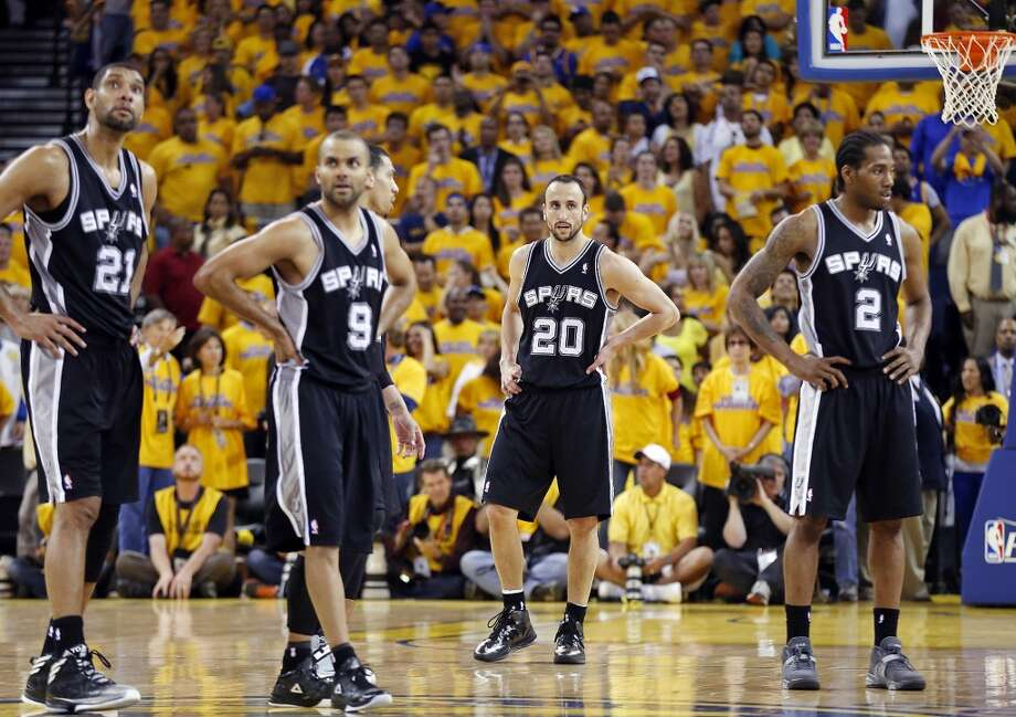 The Spurs' Tim Duncan (from left), Tony Parker, Danny Green, Manu Ginobili and Kawhi Leonard pause during overtime action in Game 4 of the Western Conference semifinals against the Golden State Warriors on Sunday, May 12, 2013 at Oracle Arena in Oakland. The Warriors won 97-87 in overtime.