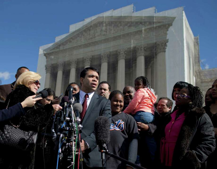 FILE - In this Feb. 27, 2013 file photo special counsel of the NAACP Legal Defense Fund, Debo Adegbile, speaks with the media outside the Supreme Court in Washington after presenting arguments in the Shelby County, Ala., v. Holder voting rights case. At the time Adegbile was the first, and as it turned out, the only, African-American to make a high court argument this term. The numbers were marginally better for Hispanic lawyers, four of whom argued for a total of 1 hour, 45 minutes. Women were better represented, accounting for just over 17 percent of the arguments before the justices. (AP Photo/Evan Vucci, File) Photo: Evan Vucci