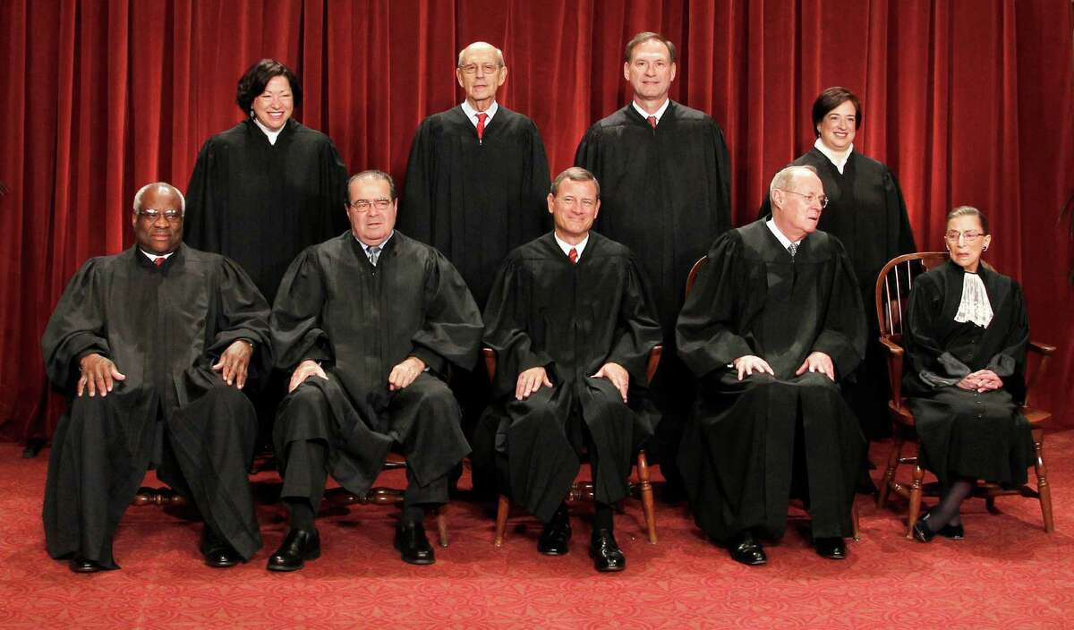 U.S. Supreme Court justices gather for a group portrait. Seated from left are: Clarence Thomas, Antonin Scalia, Chief Justice John Roberts, Anthony M. Kennedy and Ruth Bader Ginsburg. Standing, from left are: Sonia Sotomayor, Stephen Breyer, Samuel Alito Jr., and Elena Kagan.