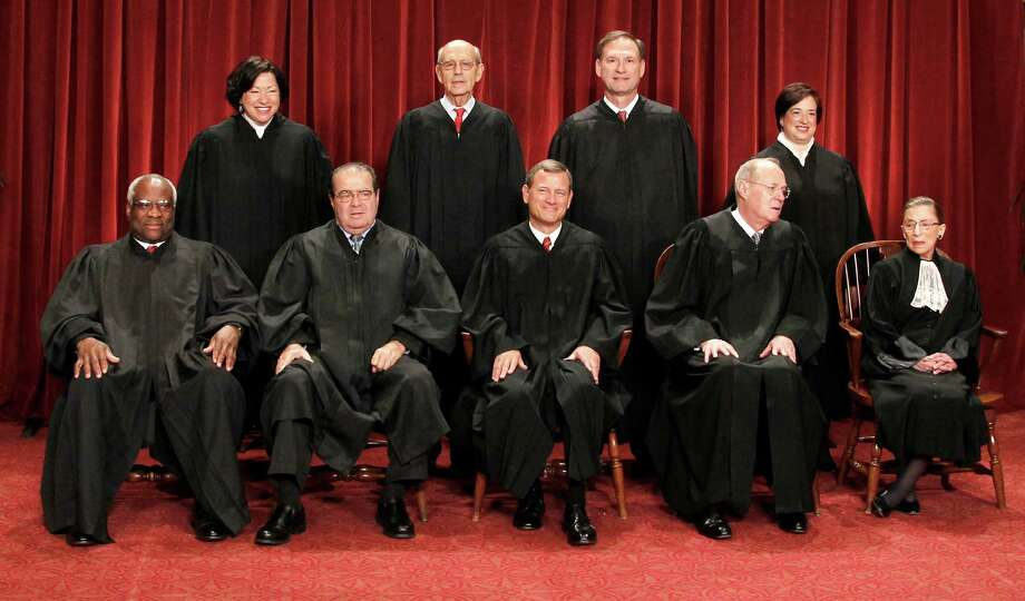U.S. Supreme Court justices gather for a group portrait. Seated from left are: Clarence Thomas, Antonin Scalia, Chief Justice John Roberts, Anthony M. Kennedy and Ruth Bader Ginsburg. Standing, from left are: Sonia Sotomayor, Stephen Breyer, Samuel Alito Jr., and Elena Kagan. Photo: Pablo Martinez Monsivais