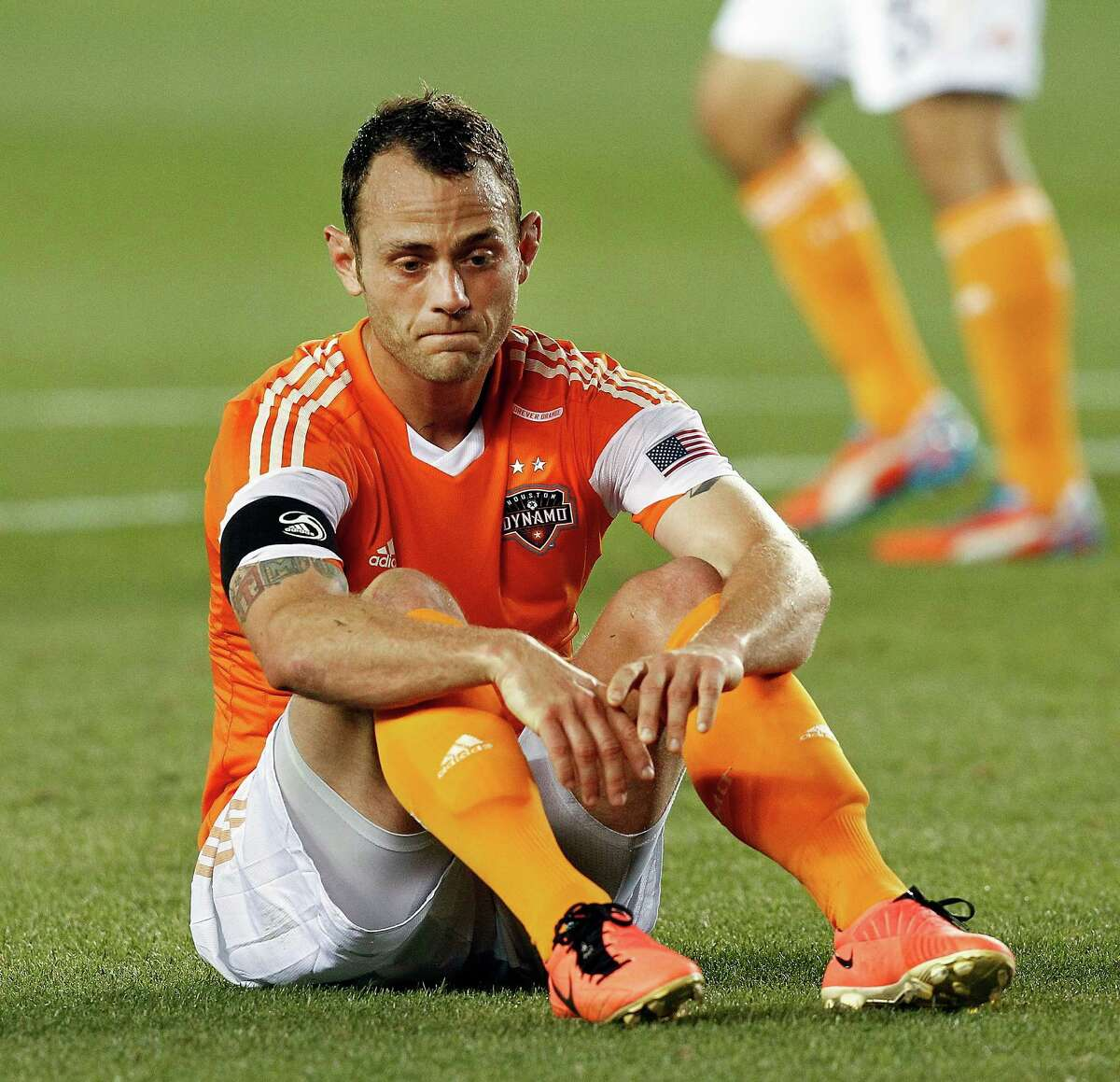 Sporting KC 1, Dynamo 0 Houston Dynamo midfielder Brad Davis #11 sits on the field after missing a scoring opportunity late in the second half against the Sporting KC during a MLS soccer match between the Houston Dynamo and the Sporting KC, Sunday May 12, 2013. Sporting KC defeated the Houston Dynamo 1-0. (Bob Levey/For The Chronicle)