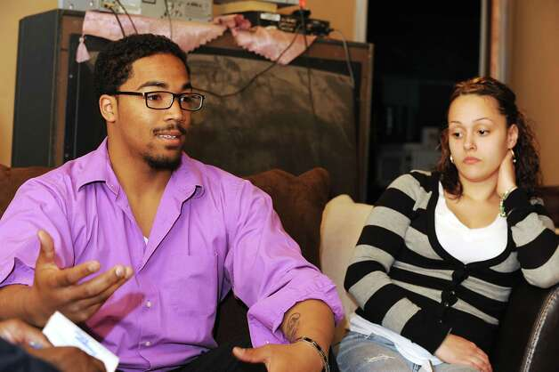 DC Dunkel, 20, is interviewed with his fiancee Vanessa Hernandez, 20, in his home on Wednesday, April 24, 2013 in Schenectady, N.Y. Dunkel was forced to take care of his three siblings, after their mother was charged with the fatal beating her 8-year-old grandson. Dunkle has a young child of his own and his fiancee is pregnant. As a result, the community is planning a fund-raiser to help pay for a van to transport everyone around. He also recently lost his job because of child care issues related to the younger kids. (Lori Van Buren / Times Union) Photo: Lori Van Buren / 10022108A