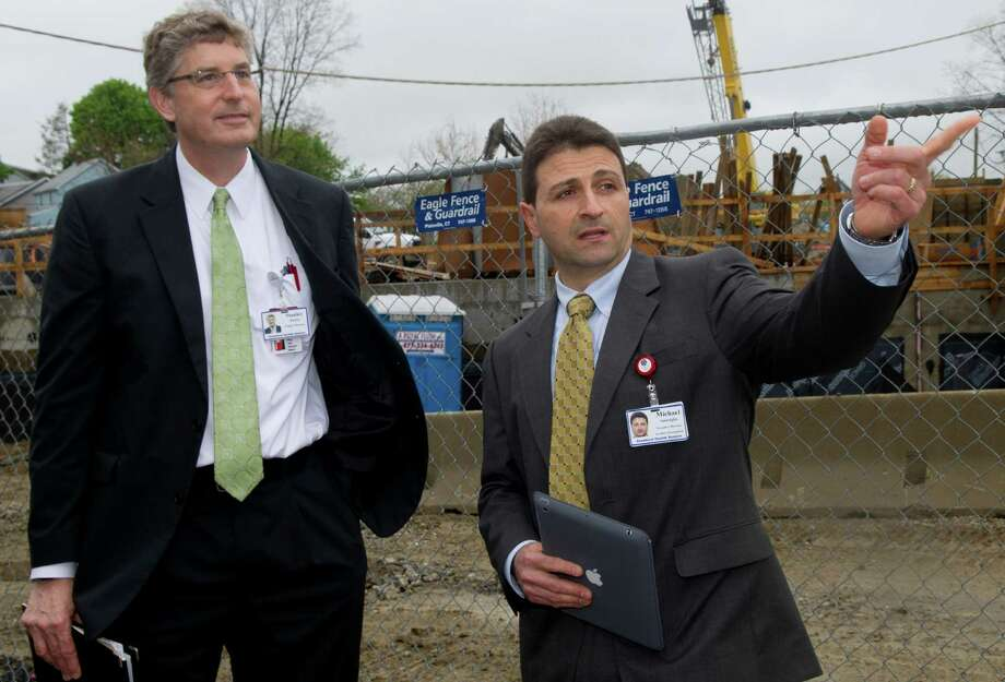Stanley Hunter, Project Director, left, and Michael Smeriglio, Executive Director of Facilities Management, right, talk about construction at Stamford Hospital on Wednesday, May 8, 2013. Photo: Lindsay Perry / Stamford Advocate