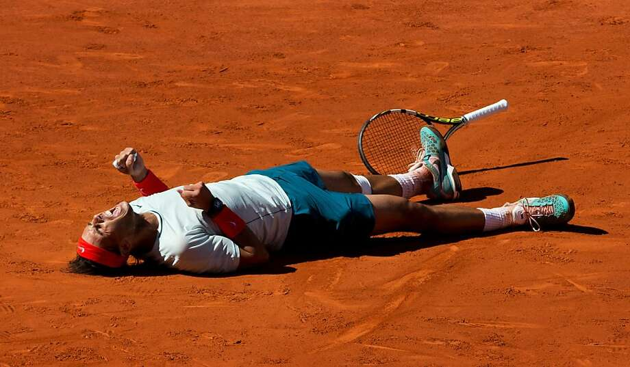 MADRID, SPAIN - MAY 12:  Rafael Nadal of Spain falls on his back celebrating matchpoint over Stanislas Wawrinka of Switzerland after winning the final match on day nine of the Mutua Madrid Open tennis tournament at the Caja Magica  on May 12, 2013 in Madrid, Spain.  (Photo by Jasper Juinen/Getty Images) *** BESTPIX *** Photo: Jasper Juinen, Getty Images