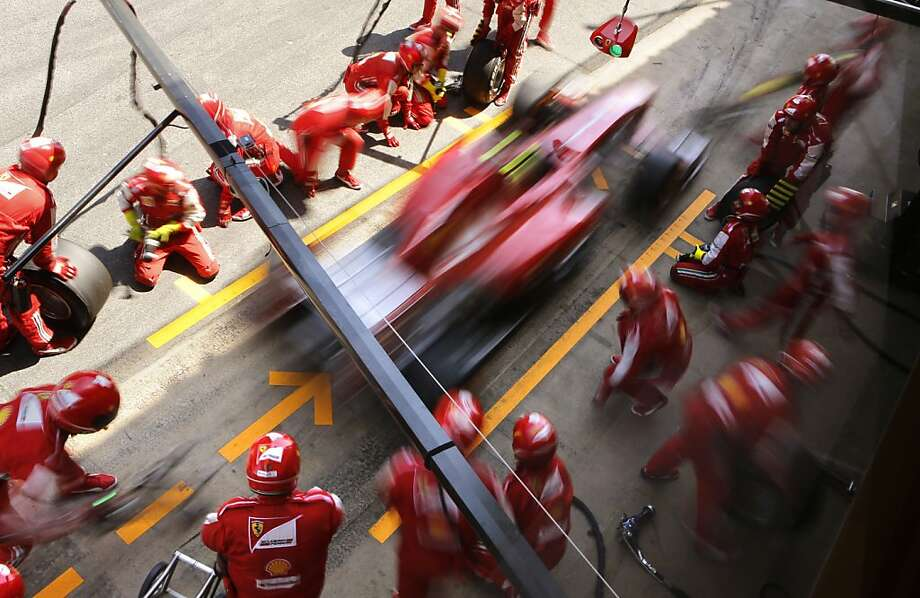Ferrari driver Felipe Massa of Brazil leaves his box after changing the wells of his car during the Formula One Spanish Grand Prix at the Catalunya racetrack in Montmelo, near Barcelona, Spain, Sunday, May 12, 2013. (AP Photo/Emilio Morenatti) Photo: Emilio Morenatti, Associated Press