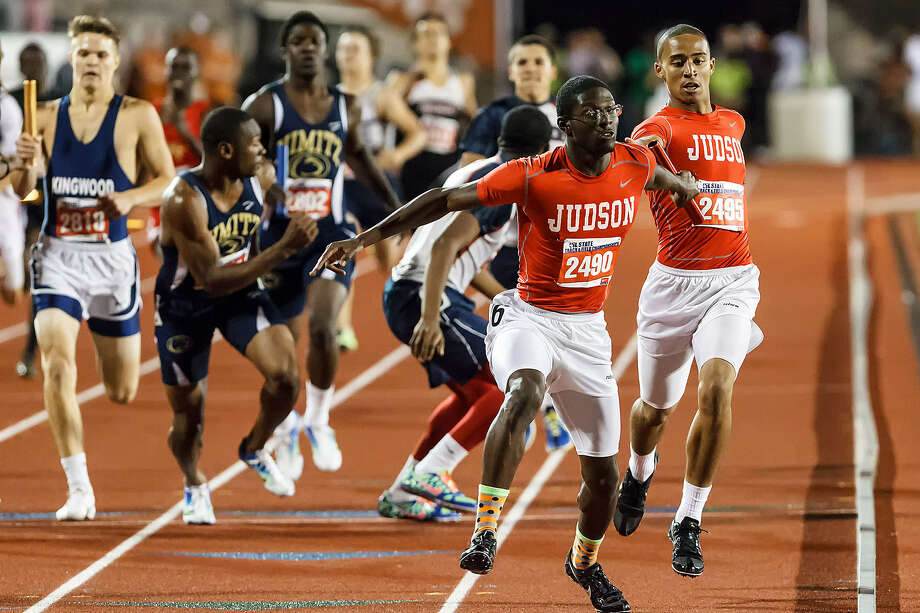 Judson's Jerome Gatewood takes the handoff from Brandon Sanders (right) to start the anchor leg in the 1,600-meter relay at the 5A state track meet. The Rockets won to clinch the team title. Photo: Marvin Pfeiffer / San Antonio Express-News