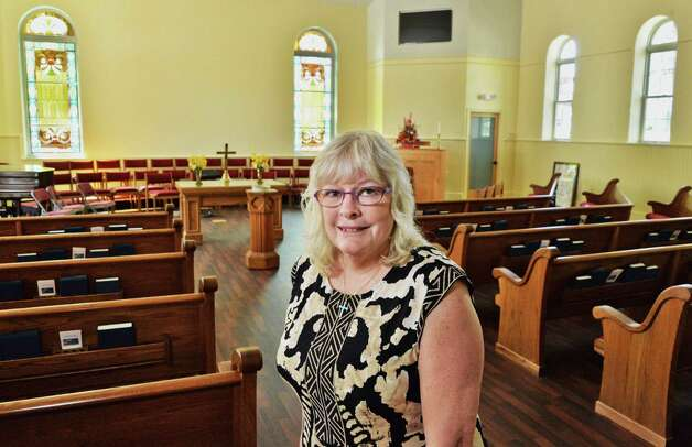 Rev. Bonnie Orth in the sanctuary of the newly rebuilt Mayfield Presbyterian Church in Mayfield, NY Tuesday May 7, 2013.  (John Carl D'Annibale / Times Union Photo: John Carl D'Annibale / 00022307A