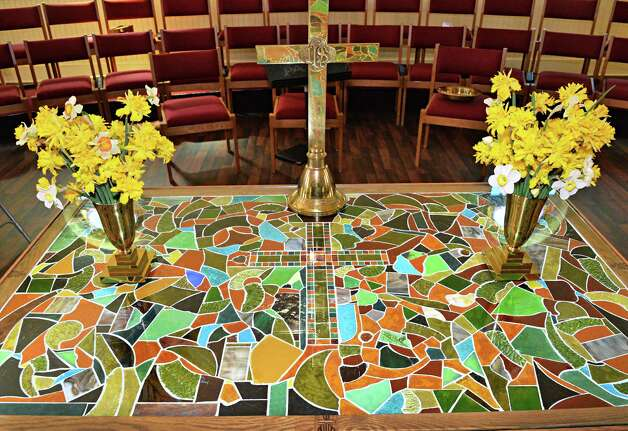 Communion table made of recovered shards of stained glass inside the sanctuary of the newly rebuilt Mayfield Presbyterian Church in Mayfield, NY Tuesday May 7, 2013.  (John Carl D'Annibale / Times Union Photo: John Carl D'Annibale / 00022307A