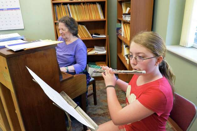 Music director Mary Lou Bryan, left, and Katie Frisch, 12, practice for the upcoming Penticost services in the music room at the newly rebuilt Mayfield Presbyterian Church in Mayfield, NY Tuesday May 7, 2013.  (John Carl D'Annibale / Times Union Photo: John Carl D'Annibale / 00022307A
