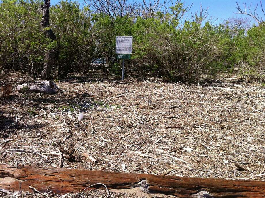 Piles of debris and rocks swept onto Cockenoe Island by Superstorm Sandy obliterated campsites and fire pits, prompting officials this week to prohibit overnight camping and fires on the island.  WESTPORT NEWS, CT 5/8/13 Photo: Westport Conservation Department / Westport News contributed