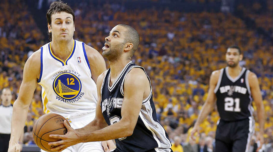 Tony Parker played more than 40 minutes and had 17 points and 3 assists despite dealing with a sore left calf in Sunday's Game 4 loss to the Warriors. Edward A. Ornelas / San Antonio Express-News