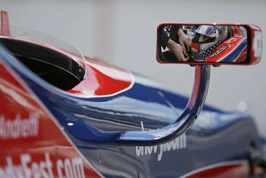 Marco Andretti is reflected in the mirror of his car as he prepares to drive during practice for the Indianapolis 500 auto race at the Indianapolis Motor Speedway in Indianapolis, Sunday, May 12, 2013. (AP Photo/Darron Cummings) Photo: Darron Cummings, Associated Press