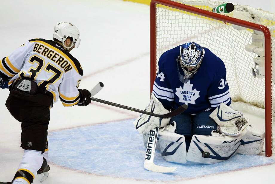 Maple Leafs goalie James Reimer, who didn't let anything get past him until the final minute of the game, makes a save on the Bruins' Patrice Bergeron. Photo: Nathan Denette, SUB / CP