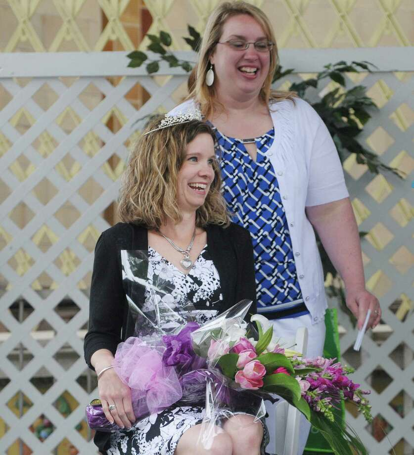 Christy Bunkoff of Watervliet, smiles after being crowned  Mother of the Year as her friend Veronica Alaimo, who nominated her stand behind at the Albany Tulip Festival at Washington Park on Sunday, May 12, 2013 in Albany, NY.   (Paul Buckowski / Times Union) Photo: Paul Buckowski
