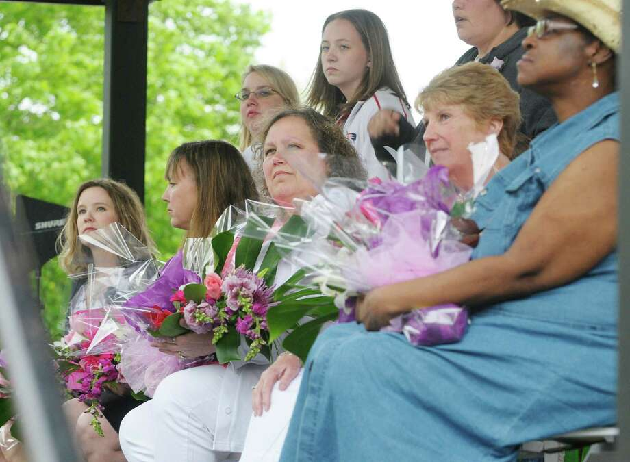 Mother of the Year finalists, seated from left,  Christy Bunkoff of Watervliet, Heather Corey-Mongue of Glenmont, Charlene Dobert of Troy, Barbara Quinn of Delmar and Gwenndolynn Thompson-Chappell of Albany sit on stage as they wait to see who will be crowned Mother of the Year at  the Albany Tulip Festival at Washington Park on Sunday, May 12, 2013 in Albany, NY.  Bunkoff was crowned  Mother of the Year.  Bunkoff has three children, two boys and a girl between the ages of nine and twelve.  (Paul Buckowski / Times Union) Photo: Paul Buckowski